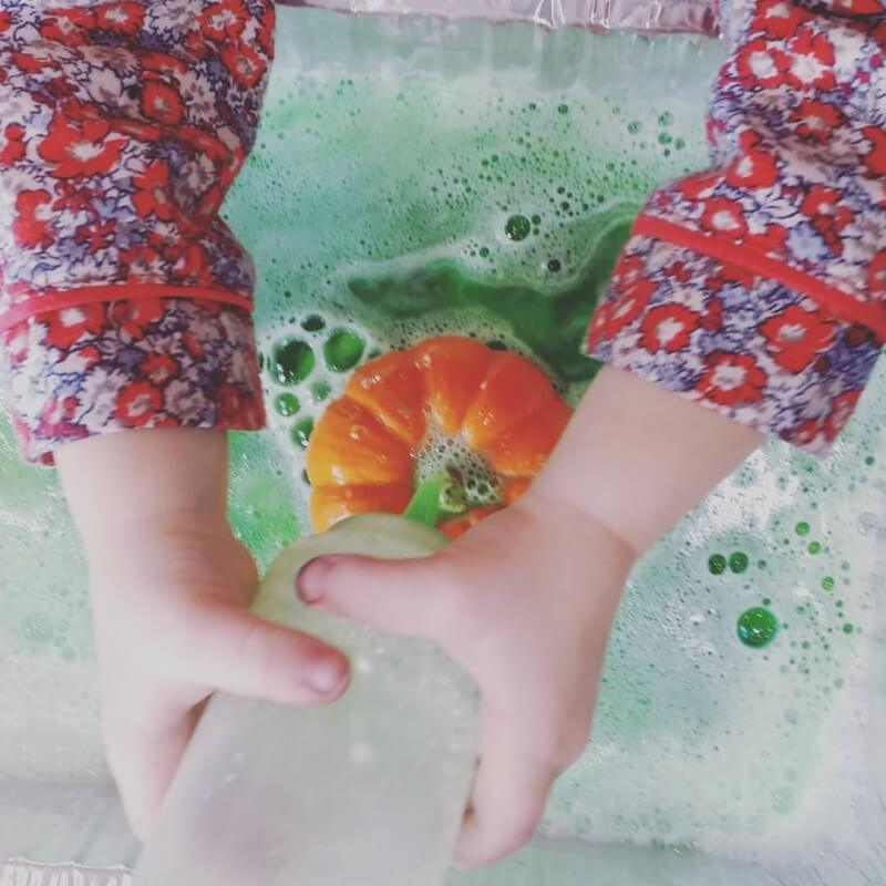 toddler science experiment with pumpkins