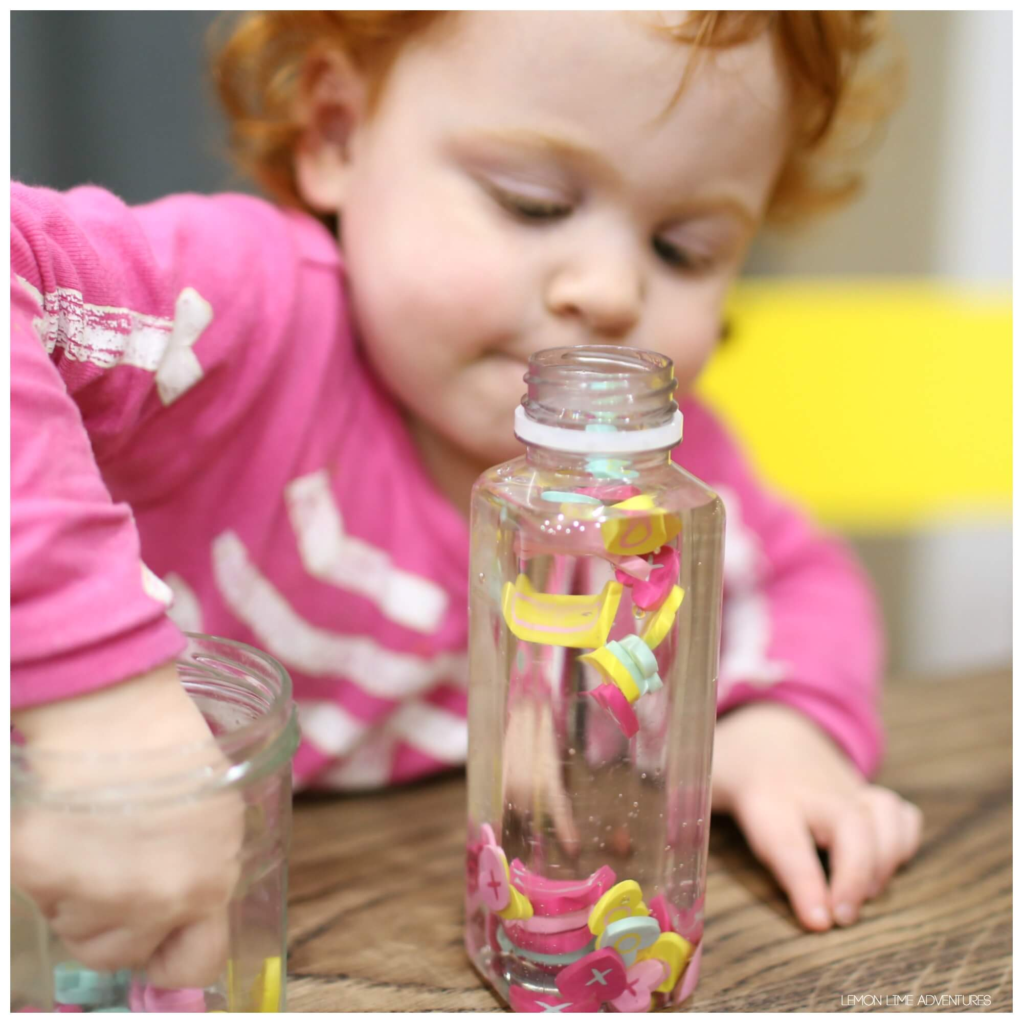 making sensory bottles with toddlers