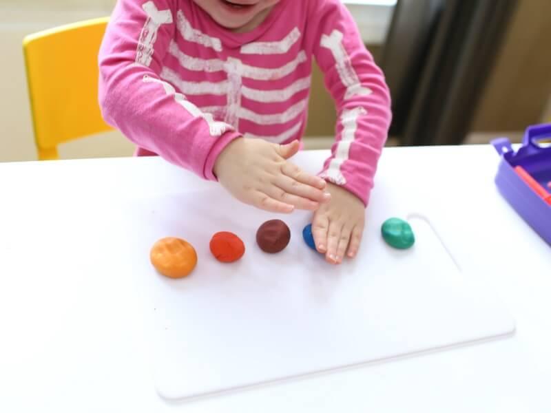 Smashing play dough proprioceptive input