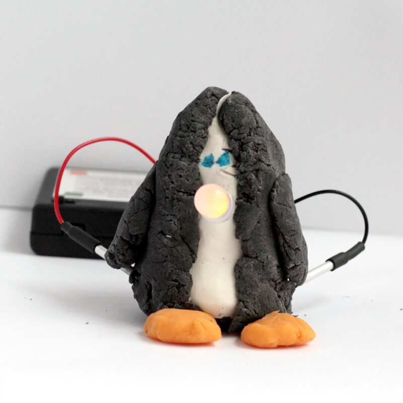 We love Squishy Circuits! Use these delightful circuits to make your very own light-up penguin STEM activity! Kids will love it!
