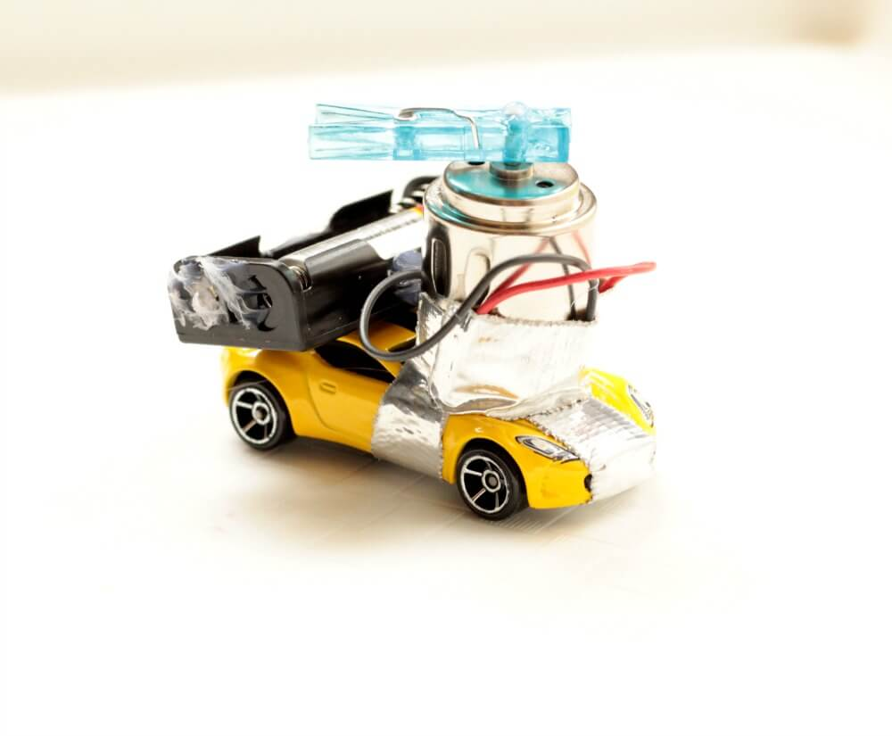 Kids will have a blast learning about electrical engineering, circuits, and motors in this DIY motorized toy car STEM challenge. Can you make a car move?